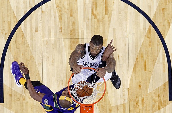 Brooklyn Nets forward Thomas Robinson (41) slam dunks over New Orleans Pelicans forward Dante Cunningham (44) in the first half of an NBA basketball game in New Orleans, Saturday, Jan. 30, 2016. (AP Photo/Gerald Herbert)