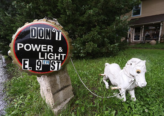 A sign critical of the East Ninth Street Project sits on display outside a home on the 700 block of Rhode Island Street, Monday, May 23, 2016.