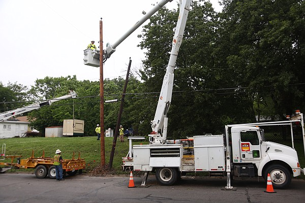 Electrical crews contracted by Westar Energy repair power lines near Fifth and Alabama streets, Friday morning, May 27, 2016.