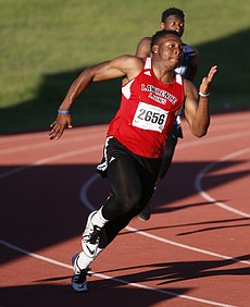 Lawrence High School's JD Woods competes in the 200 at the Kansas state track meet, on Saturday in Wichita.