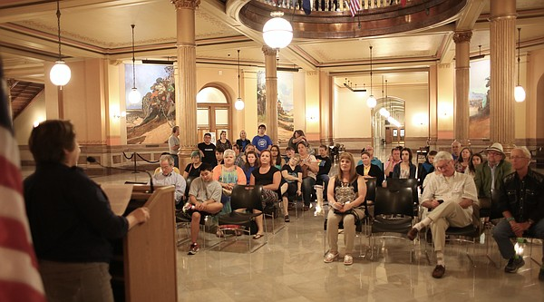 Lynn Barnett, left, speaks at a rally of LGBT supporters Wednesday, June 1, 2016, at the Kansas Statehouse in Topeka. Barnett, a social worker and therapist from Kansas City, Missouri, has a transgender son and spoke about issues of transgender equality as lawmakers met about similar issues.