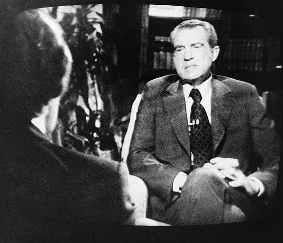 Former President Richard Nixon, right, listens to questions by David Frost during Wednesday night, May 5, 1977 telecast interview. Interview took place in rented house in South Laguna, Calif, near the former President's home in San Clemente. (AP Photo/Ray Stubblebine)