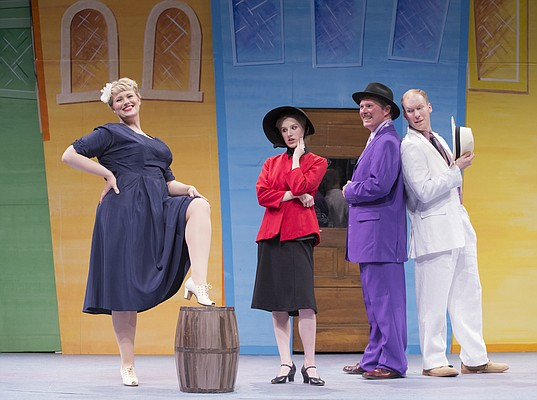 Guys and Dolls cast members Secily Krumins, playing Miss Adelaide, Noelle Olson, playing Sarah Brown, John Robison, playing Nathan Detroit, and Christoph Cording, playing Sky Masterson, are pictured Thursday, June 2, 2016, at Theatre Lawrence, 4660 Bauer Farm Drive.