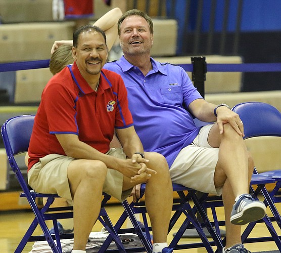 Kansas head coach Bill Self and assistant coach Kurtis Townsend watch with smiles during the campers vs. counselors scrimmage, Wednesday, June 8, 2016 at the Horejsi Athletic Center.