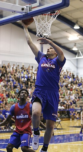 Blue Team center Evan Maxwell gets a bucket over against Red Team guard LaGerald Vick during the Bill Self basketball camp alumni scrimmage, Wednesday, June 8, 2016 at the Horejsi Athletic Center.