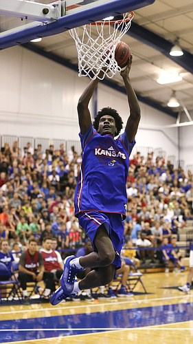 Blue Team guard Josh Jackson soars in for a dunk during the Bill Self basketball camp alumni scrimmage, Wednesday, June 8, 2016 at the Horejsi Athletic Center.
