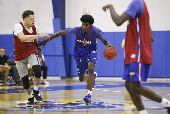 Blue Team guard Josh Jackson drives against Red Team guard Brannen Greene during the Bill Self basketball camp alumni scrimmage, Wednesday, June 8, 2016 at the Horejsi Athletic Center.