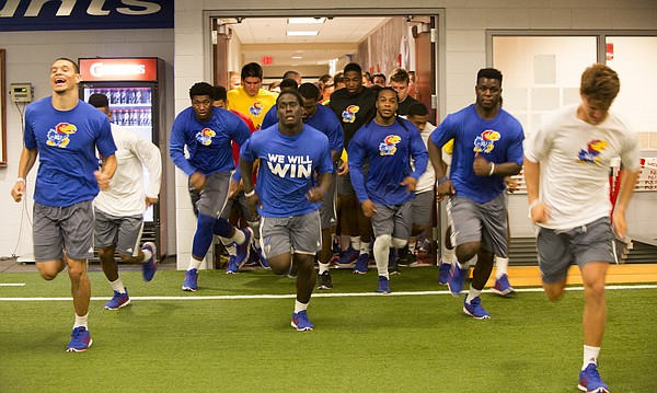 KU football recruits head into the weight room Friday morning at the Anderson Sports Complex as KU football practice starts early in the morning as the players go through a rigorous session for conditioning.