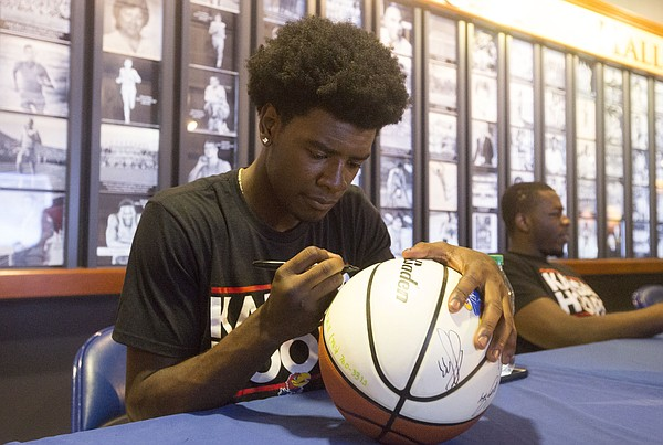 Incoming freshman Josh Jackson autographs a basketball during Bill Self camp registration on June 12 at Allen Fieldhouse.