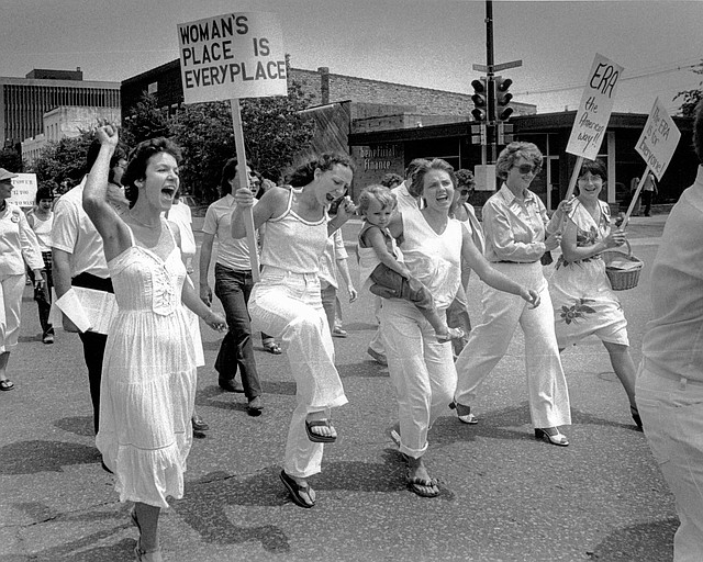 Photo: A line of women's rights supporters, including ...
