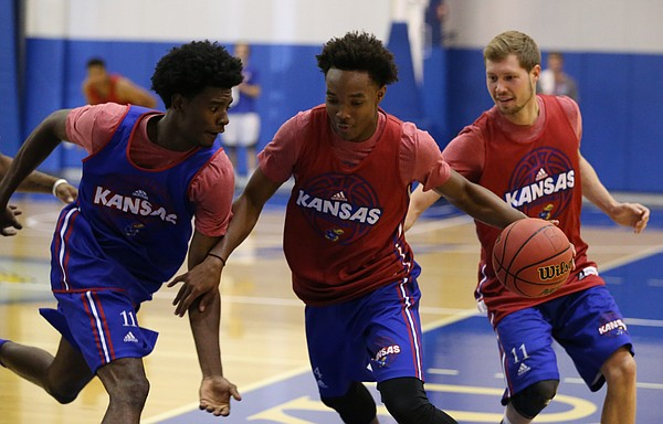 Blue Team guard Josh Jackson looks to strip the ball from Red Team guard Devonte' Graham on Wednesday, June 15, 2016 at the Horejsi Athletic Center.