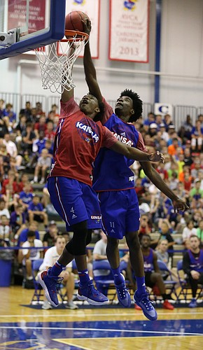 Red Team guard Devonte' Graham has his dunk stuffed at the rim by Blue Team guard Josh Jackson on Wednesday, June 15, 2016 at the Horejsi Athletic Center.