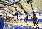 Blue Team guard Frank Mason III soars in to the bucket on Wednesday, June 15, 2016 at the Horejsi Athletic Center.