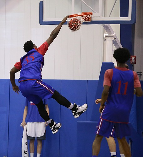 Blue Team center Udoka Azabuike  brings down a dunk on Wednesday, June 15, 2016 at the Horejsi Athletic Center.