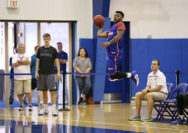 Blue Team guard Frank Mason III turns to save a ball headed out of bounds.