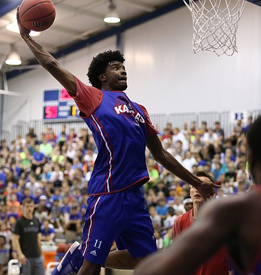 Blue Team guard Josh Jackson comes in for a dunk.
