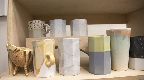 Cups rest on a shelf in Christy Wittmer's studio at the Lawrence Arts Center, 940 New Hampshire St.