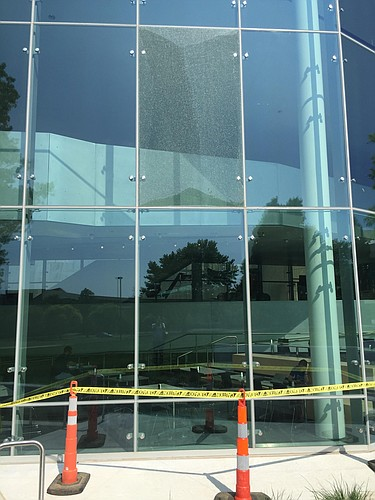 A shattered glass pane on the Naismith Drive side of Kansas University's DeBruce Center is pictured Monday, June 20, 2016. The building settling caused the pane to break, and it should be replaced in a few weeks, according to the center director.