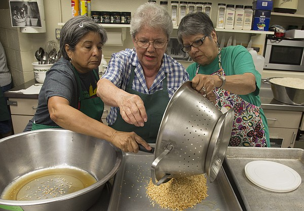 From left, Judy Romero, Bertha Bermudez and Val Howland spread some rice out to cool to be used to make sopa in preparation for this weekend's annual St. John's Mexican Fiesta. The fiesta will be held from 6-11:30 p.m. Friday and Saturday at St. John the Evangelist Catholic Church, 1234 Kentucky St.