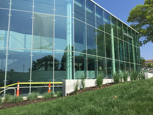 A shattered glass pane on the Naismith Drive side of Kansas University's DeBruce Center is pictured Monday, June 20, 2016.