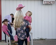 A family lines up for tickets to an evening performance at the Flint Hills Rodeo in Strong City, June 3, 2016.