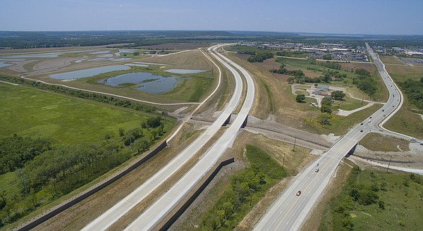 The east leg of the South Lawrence Trafficway, left, is shown on Tuesday, June 21, 2016. The highway, which runs parallel to 31st Street, remains under construction and is expected to open this fall.