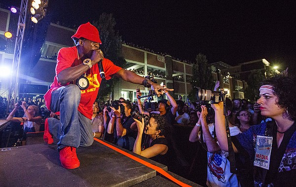 Public Enemy's Flavor Flav points out to the crowd during a free concert Saturday evening, June 25, 2016, as part of the Free State Festival.