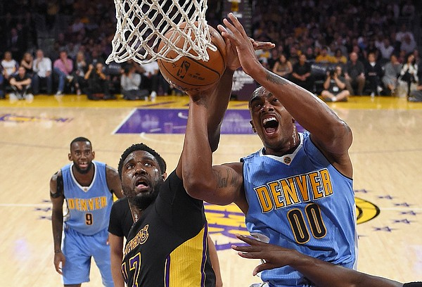 Denver Nuggets forward Darrell Arthur, right, shoots as Los Angeles Lakers center Roy Hibbert defends during the first half of an NBA basketball game Friday, March 25, 2016, in Los Angeles. AP Photo/Mark J. Terrill)