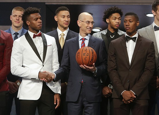 NBA Commissioner Adam Silver, center, poses for photos with prospective NBA draft picks Buddy Hield, left, Kris Dunn, right, Ben Simmons, third from left, and Brandon Ingram, second from right, before the NBA basketball draft, Thursday, June 23, 2016, in New York. (AP Photo/Frank Franklin II)