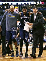 Memphis Grizzlies guard Mario Chalmers (6) is helped from the court after injuring his right leg during the third quarter of an NBA basketball game against the Boston Celtics in Boston, Wednesday, March 9, 2016. (AP Photo/Charles Krupa)