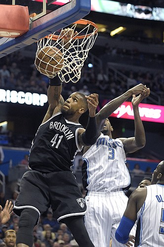 Brooklyn Nets forward Thomas Robinson (41) dunks the ball in front of Orlando Magic center Dewayne Dedmon (3) and guard Victor Oladipo (5) during the second half of an NBA basketball game in Orlando, Fla., Tuesday, March 29, 2016. The Magic won 139-105. (AP Photo/Phelan M. Ebenhack)