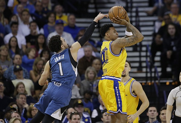 Golden State Warriors' Brandon Rush, right, shoots over Minnesota Timberwolves' Tyus Jones (1) during the first half of an NBA basketball game Tuesday, April 5, 2016, in Oakland, Calif. (AP Photo/Marcio Jose Sanchez)