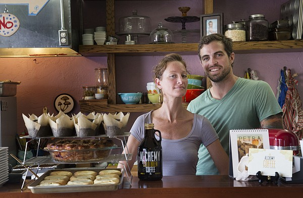 Alchemy Coffee and Bake House owners Benjamin Farmer, right, and Joni Alexander pose at their shop, 1901 Massachusetts St., which was recently voted Best of Lawrence 2016.