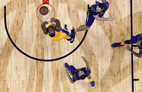 Los Angeles Lakers center Tarik Black (28) slam dunks against New Orleans Pelicans forward Ryan Anderson, top right, in the second half of an NBA basketball game in New Orleans, Thursday, Feb. 4, 2016. The Lakers won 99-96. (AP Photo/Gerald Herbert)