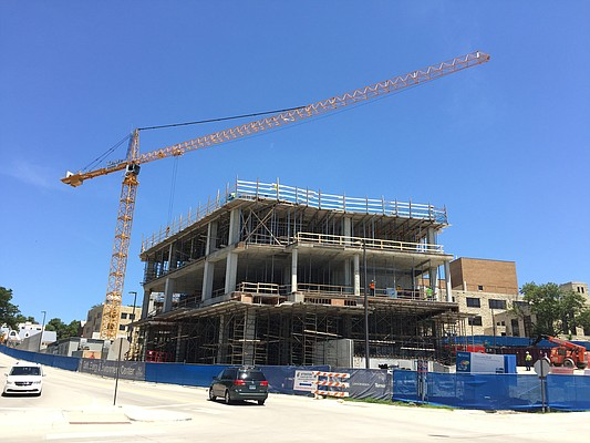 Construction on KU's new Earth, Energy and Environment Center, or EEEC, on the northeast corner of 15th Street and Naismith Drive, is pictured on Wednesday, July 6, 2016. Adjacent to Lindley Hall, the building — featuring two towers, Ritchie Hall and Slawson Hall — is scheduled for completion in fall 2017.