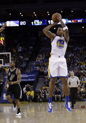 Golden State Warriors' Brandon Rush (4) shoots against the San Antonio Spurs during the first half of an NBA basketball game Thursday, April 7, 2016, in Oakland, Calif. (AP Photo/Marcio Jose Sanchez)