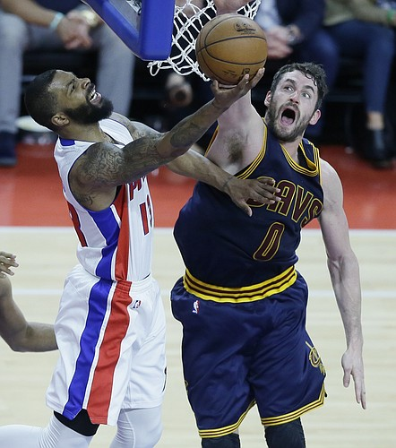 Detroit Pistons forward Marcus Morris (13) makes a layup while defended by Cleveland Cavaliers forward Kevin Love (0) during the first half in Game 3 of a first-round NBA basketball playoff series Friday, April 22, 2016, in Auburn Hills, Mich. (AP Photo/Carlos Osorio)