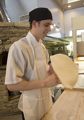 Zach Frieling, line manager at Limestone Pizza, prepares pizzas at the 814 Massachusetts St. eatery. Frieling won first place in the culinary arts competition last month at the SkillsUSA National Leadership and Skills Conference in Louisville, Ky.