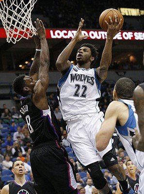 Minnesota Timberwolves guard Andrew Wiggins (22) goes up for a shot against Los Angeles Clippers forward Jeff Green (8) during the first half of an NBA basketball game in Minneapolis, Wednesday, March 30, 2016. (AP Photo/Ann Heisenfelt)