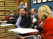 Bryan Caskey, director of elections for the Kansas Secretary of State's office, and Sen. Vicki Schmidt, R-Topeka, debate a new regulation that will require some voters in the upcoming elections who have not yet shown proof of U.S. citizenship to cast provisional ballots so they can only vote in federal races.