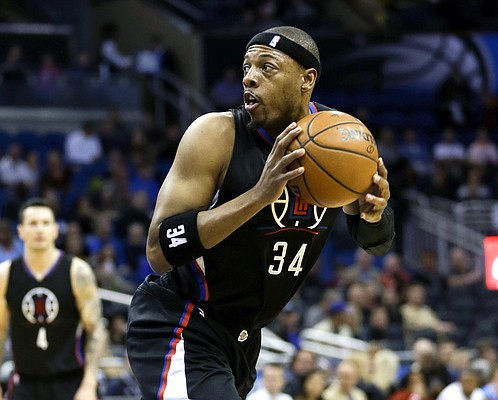 Los Angeles Clippers forward Paul Pierce looks for an open shot against the Orlando Magic during the first half of an NBA basketball game, Friday, Feb. 5, 2016, in Orlando, Fla. (AP Photo/John Raoux)
