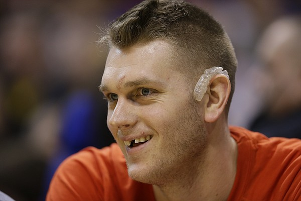 FILE — Los Angeles Clippers center Cole Aldrich (45) on the bench during the second half of an NBA basketball game against the Indiana Pacers in Indianapolis, Tuesday, Jan. 26, 2016. The former Kansas big man was introduced Thursday as a new member of his hometown Minnesota Timberwolves. (AP Photo/Michael Conroy)