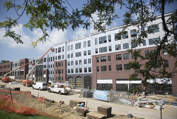 The HERE Kansas apartment and retail project at 1111 Indiana St. is seen looking south from the intersection of 11th and Indiana streets, Monday, July 18, 2016.