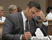 Kansas Secretary of State Kris Kobach listens and takes note as a judge declares in Shawnee County District Court that the state must count potentially thousands of votes from people who registered without providing documentation of their U.S. citizenship, Friday, July 29, 2016, in Topeka. Kobach had directed local election officials to count only their votes in federal races, not state and local ones.
