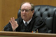 Shawnee County, Kan., District Judge Larry Hendricks makes a comment during a hearing on requiring the state to count potentially thousands of votes in state and local elections from people who've registered without providing proof of their U.S. citizenship, Friday, July 29, 2016, in Topeka. Hendricks has ruled that the state is required to count all their votes.