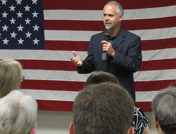 In this July 25, 2016 photo, U.S. Rep. Tim Huelskamp, R-Kan., speaks during a campaign town hall meeting at the headquarters of Patriot Outfitters, which sells firearms, accessories and hunting and military gear in St. Marys. Huelskamp is locked in a tough GOP primary race against Roger Marshall, a Great Bend obstetrician.