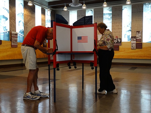 Larry Maxey, left, and Verna Froese, of Lawrence, cast ballots at the Carnegie Building, 200 W. Ninth St., for the primary elections on Tuesday, Aug. 2, 2016.