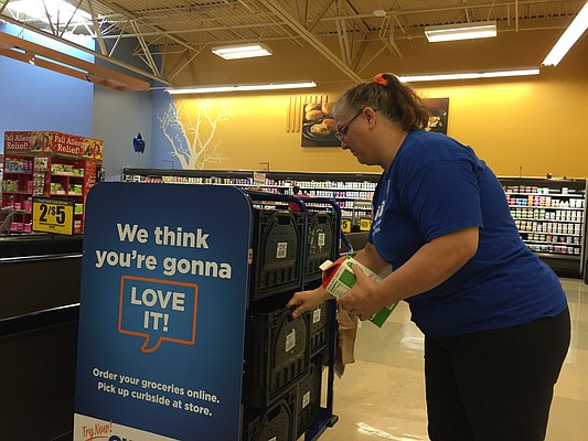 Dillons employee Stephanie Givens fills an order for the grocery's new online shopping service, ClickList.
