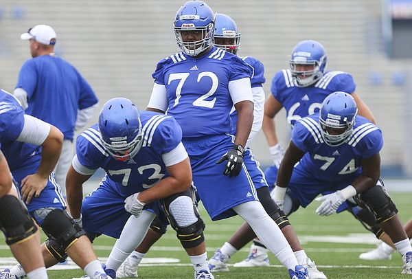 Kansas newcomer, Charles Baldwin, 72, a transfer from Alabama, gets stretched out with the offensive line during practice on Monday, Aug. 15, 2016 at Memorial Stadium.