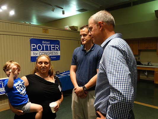 Former Rep. Paul Davis, left, has been stumping for Democratic candidates throughout Kansas this year, leading some to speculate he may be weighing another bid for governor in 2018. Potter was accompanied at the event by her son Reiden and her husband David.